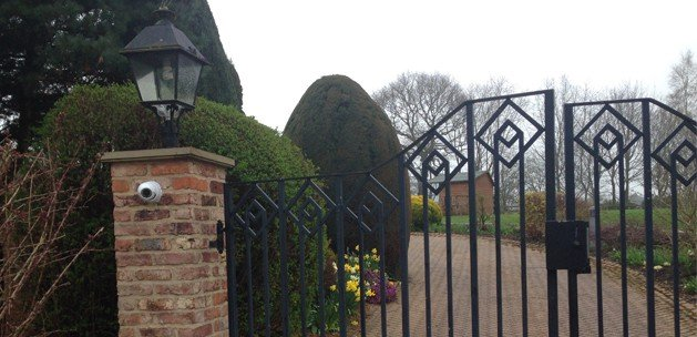 Dome camera residential CCTV installed on gate post