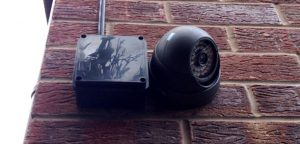 HD dome camera on side of house